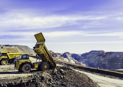 Dumper truck tilting the ore load in the open pit mine of Riotin